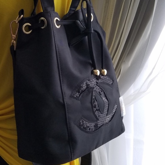 7c0215d5bc0 CHANEL Bags   Vip Gift Sequin Logo Nylon Bucket Bag   Poshmark